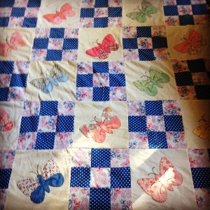 The butterfly blocks combined with nine patch blocks.