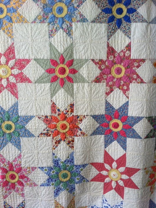 Missouri Daisy quilt made with reproduction and vintage fabrics. Includes some feed sacks.