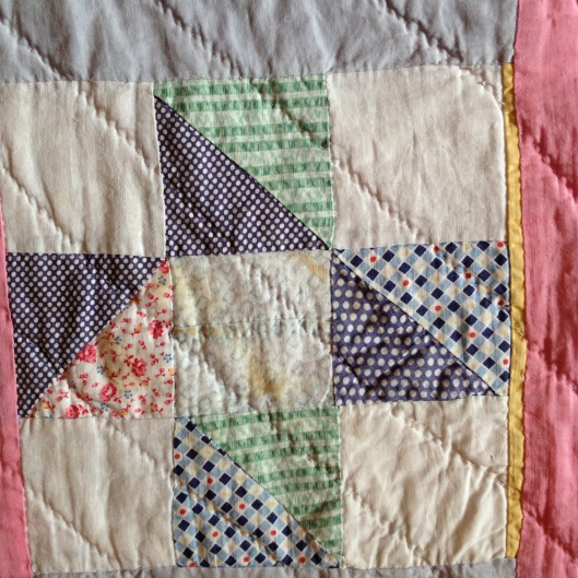 Block detail with hand quilting.