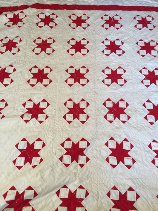 Antique Red and White Star quilt.