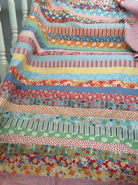 Jelly roll quilt - machine quilting in progress.