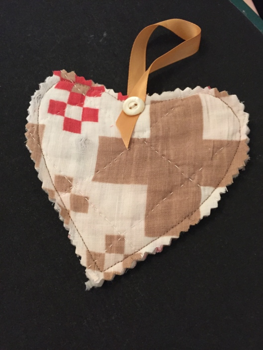 A heart shape cut from the Darting Birds quilt .